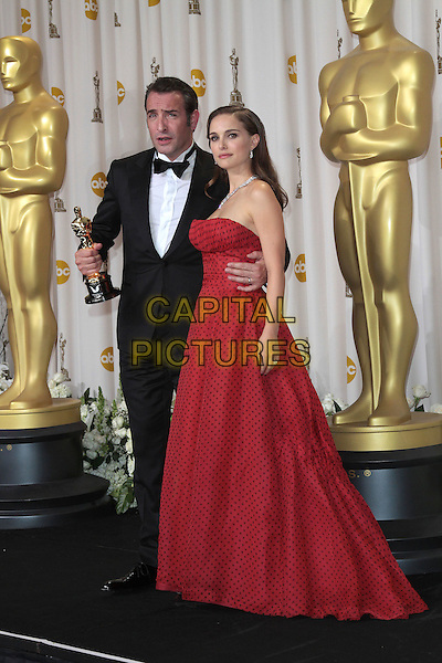 Jean Dujardin & Natalie Portman.84th Annual Academy Awards held at the Hollywood & Highland Center, Hollywood, California, USA..February 26th, 2012.oscars full length black tuxedo red dress strapless polka dot award trophy winner .CAP/ADM/SLP/JO.©James Orken/ SLP/AdMedia/Capital Pictures.