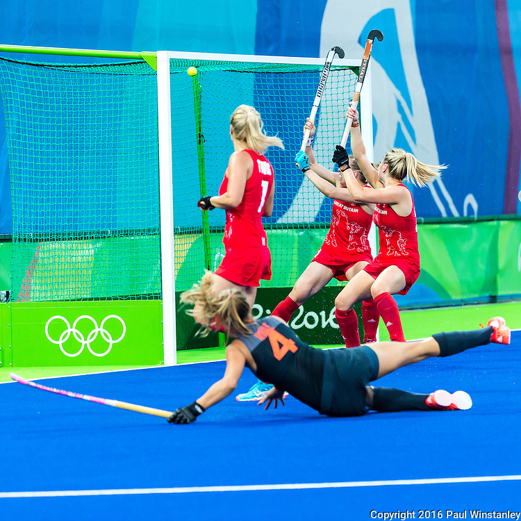 Kitty van Male #4 of Netherlands watches as Georgie Twigg #7 of Great Britain fails to stop be ball during Netherlands vs Great Britain in the gold medal final at the Rio 2016 Olympics at the Olympic Hockey Centre in Rio de Janeiro, Brazil.