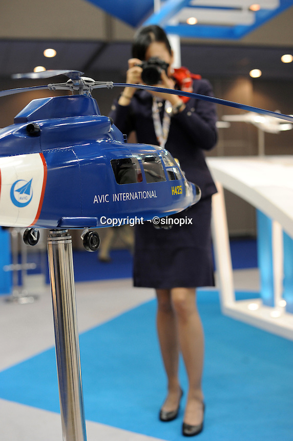 H425, latest type of the most successful series helicopter in China at Asian Aerospace 2011, Hong Kong, China. H425 is munufactured by AVIC hafei Aviation Industry Co. Ltd. the largest helicopter manufacturer in China. Asian Aerospace 2011 (Asian Aerospace International Expo and Congress) held in Hong Kong's Asia World Expo, is the world's largest single-focused exhibition and congress for the commercial aerospace and civil aviation market with particular emphasis on the Asia-Pacific region. This year a record of 270 exhibitors from 32 countries, and the number of Chinese companies increased by 42% comparing to last year..09 Mar 2011