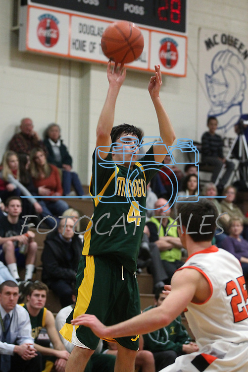 Manogue's James Sandoval shoots over Douglas defender Michael Nolting in the varsity basketball game at DHS on Tuesday, Jan. 15, 2013. Douglas won 68-49..Photo by Cathleen Allison