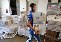 NWA Democrat-Gazette/DAVID GOTTSCHALK   Tyler Pitts, a kennel supervisor, begins to unload janitorial supplies for use and storage Friday, August 7, 2015 at the  Lester C. Howick Animal Shelter of Washington County in Fayetteville. The Animal League of Washington County made a donation of $5,000 of janitorial supplies to the shelter Friday.