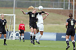 03 November 2010: Wake Forest's Jackie Logue (21) wins a header. The Wake Forest University Demon Deacons defeated the Florida State Seminoles 3-1 at Koka Booth Stadium at WakeMed Soccer Park in Cary, North Carolina in an ACC Women's Soccer Tournament Quarterfinal game.