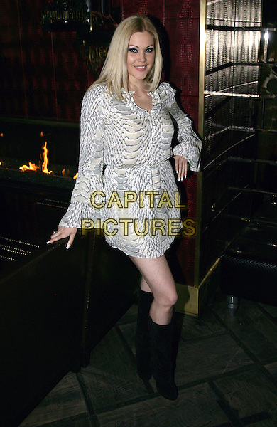 SHANNA MOAKLER .Moon Nightclub Hosts a Birthday Bash for Shanna Moakler at the Palms Resort Hotel and Casino, Las Vegas, Nevada, 17th April 2010..full length black knee high boots white grey gray snake animal print dress hand on hip.CAP/ADM/MJT.© MJT/AdMedia/Capital Pictures.