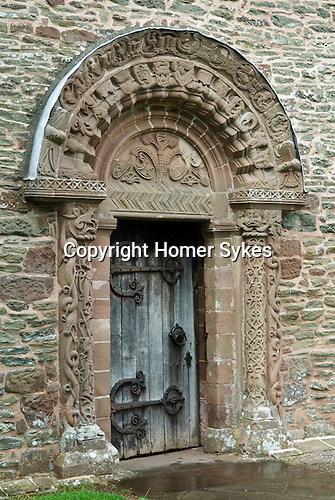 Killpeck Church front door with carvings Hereford and Worcester UK.