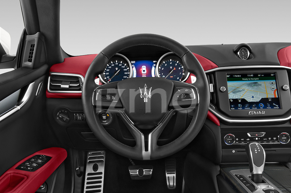 Car pictures of steering wheel view of a 2014 Maserati Ghibli Base 4 Door Sedan Steering Wheel
