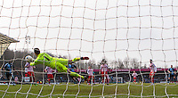 Goalkeeper Jamie Jones of Stevenage pulls off a fine save during the Sky Bet League 2 match between Wycombe Wanderers and Stevenage at Adams Park, High Wycombe, England on 12 March 2016. Photo by Andy Rowland/PRiME Media Images.