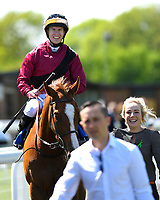 Winner of The Smith & Williamson British EBF Fillies' Handicap (Class 3), Time Change ridden by Richard Kingscote and trained by Ralph Beckett  enter the winners enclosureduring Afternoon Racing at Salisbury Racecourse on 17th May 2018