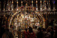 Worshippers wait inline to pray in front of the Altar of the Crucifixion. There, according to the tradition, Jesus was crucified (Golgotha, the Hill of Calvary). Jerusalem