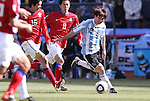 17 JUN 2010: Lionel Messi (ARG) (10) cuts past Ki Sung Yueng (KOR) (16) and Kim Jung Woo (KOR) (8). The Argentina National Team defeated the South Korea National Team 4-1 at Soccer City Stadium in Johannesburg, South Africa in a 2010 FIFA World Cup Group E match.