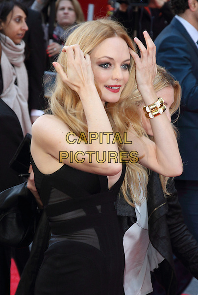 "Heather Graham.The European Premiere of ""The Hangover Part 3"", Empire Leicester Square, London, England..22nd May 2013.half length black dress hands arms gold bracelet side .CAP/ROS.©Steve Ross/Capital Pictures.."