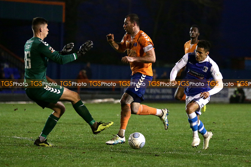 Tyler Smith of Barrow rounds George Legg of Braintree to score the second goal during Braintree Town vs Barrow, Vanarama National League Football at the IronmongeryDirect Stadium on 1st December 2018