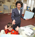 Gina Raimondo's son, Tommy, is surprised at the rapid speed with which his mother's ballot, who is running for RI General Treasurer, is pulled from his hands into the voting machine on Primary Day.