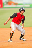 Grant Buckner (14) of the Kannapolis Intimidators takes his lead off of second base against the Rome Braves at CMC-Northeast Stadium on August 5, 2012 in Kannapolis, North Carolina.  The Intimidators defeated the Braves 9-1.  (Brian Westerholt/Four Seam Images)