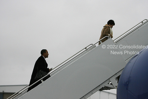 Chicago, IL - December 1, 2008 -- United States President-elect Barack Obama gets ready to board a flight to Philadelphia with adviser Valerie Jarrett on Monday afternoon, December 1, 2008 at Midway Airport in Chicago, Illinois..Credit: Anne Ryan - Pool via CNP