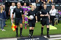 Referee Gavin Ward (C) exits the tunnel with his two assistants during the Sky Bet Championship match between Swansea City and Bristol City at the Liberty Stadium, Swansea, Wales, UK. Saturday 25 August 2018