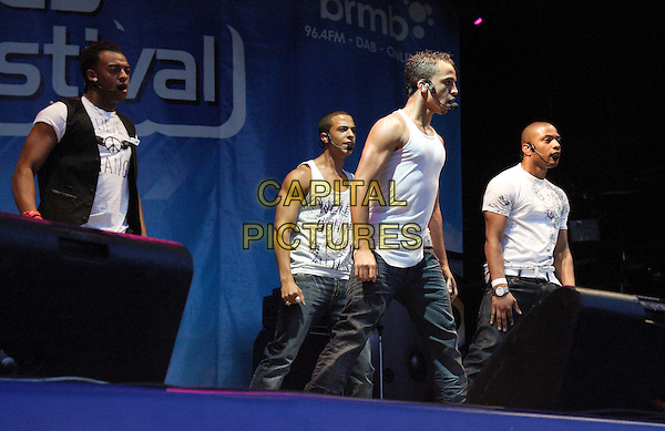 JLS (aka Jack the Lad Swing).The 'Midlands Music Festival' held at Tamworth Castle Pleasure Gardens in aid of Childrens Charity 'Just 1 Life', Tamworth, West Midlands, England..August 8th 2009.stage concert live gig performance music full length singing white tank top jeans denim dancing profile .CAP/JIL.©Jill Mayhew/Capital Pictures