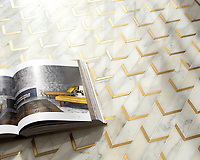 Belen, a hand-cut stone mosaic, shown in polished Calacatta and brass brushed, is part of the Bright Young Things™ collection by New Ravenna.