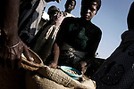 GALUFU, MALAWI OCTOBER 16: Women sell maize in a local market on October 16, 2005 in Galufu, Malawi. Most people in the village are poor and hungry, and cannot afford to buy maize at the market. The price is twice as much as the government subsidized prices. The government used to sell subsidized maize and fertilizer but not anymore. Many in the village eat mangoes and even boil unripe ones, as they cannot afford to buy anything else. The harvest was very bad in 2005 and the next one, due in April 2006 I uncertain because of lack of rains and drought. The village has seen an increase in poverty the last few years due to drought and HIV/Aids. Southern Africa has been hit by a severe hunger crisis due to drought and poverty. An ever-increasing HIV/Aids rate adds to the misery. Malawi is one of the worst hit areas and Galufu village is a typical small village that has become victim of this poverty spiral. (Photo by Per-Anders Pettersson)