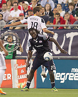 New England Revolution forward Shalrie Joseph (21) traps high pass as Los Angeles Galaxy midfielder Mike Magee (18) defends. In a Major League Soccer (MLS) match, the Los Angeles Galaxy defeated the New England Revolution, 1-0, at Gillette Stadium on May 28, 2011.