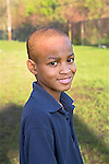 Smiling African American second grade male headshot outdoors in New Orleans