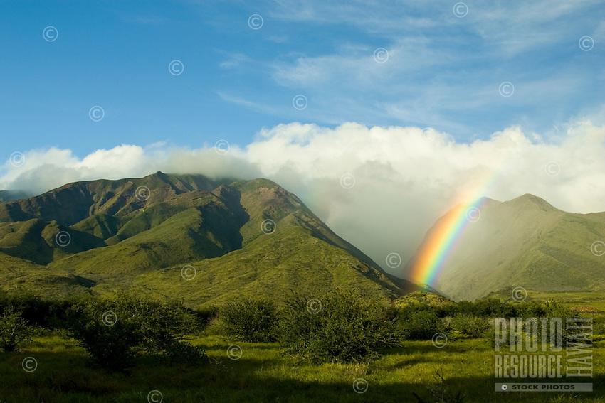 The West Maui Mountains at Olowalu, Maui with a rainbow.