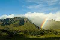 The West Maui Mountains at Olowalu, Maui with a rainbow.
