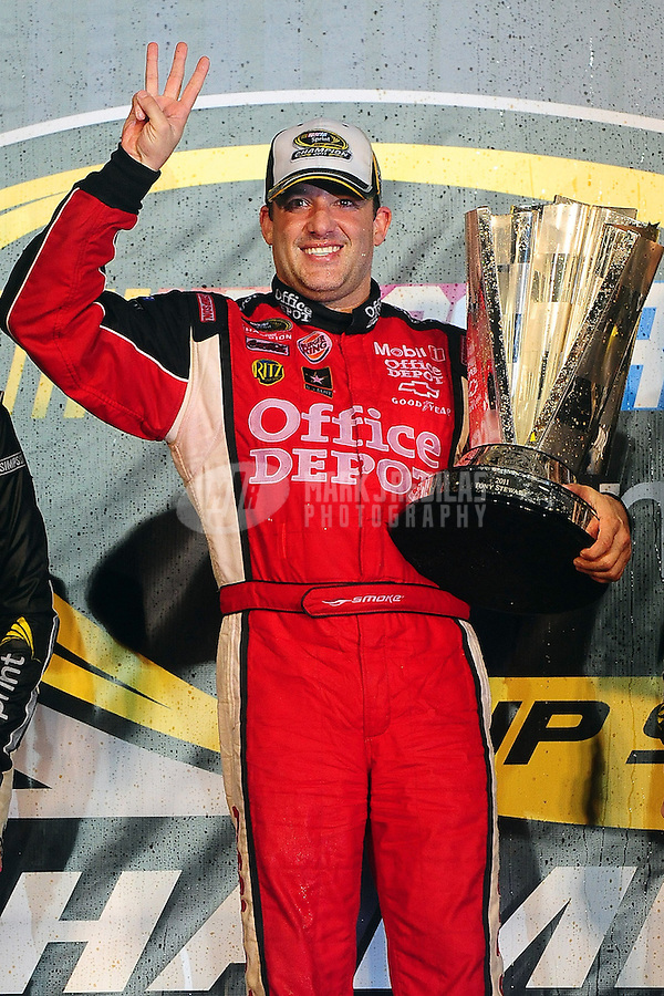 Nov 20, 2011; Homestead, FL, USA; NASCAR Sprint Cup Series driver Tony Stewart (14) celebrates winning the 2011 championship following the Ford 400 at Homestead Miami Speedway. Mandatory Credit: Mark J. Rebilas-
