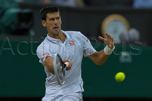 30.06.2014.  London, England.  Wimbledon Championships Day Seven Novak Djokovic of Serbia in action against Jo-Wilfried Tsonga of France during day seven men's singles fourth round match at the Wimbledon Tennis Championships at The All England Lawn Tennis Club in London, United Kingdom