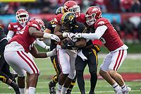 Hawgs Illustrated/BEN GOFF <br /> Jamario Bell (left), Arkansas defensive end, and Bumper Pool, Arkansas linebacker, tackle Tyler Badie, Missouri running back, in the second quarter Saturday, Nov. 29, 2019, at War Memorial Stadium in Little Rock.