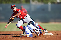 Cincinnati Reds Alejo Lopez (82) stretches for a throw as Chad McClanahan (9)  dives back to second base during an Instructional League game against the Milwaukee Brewers on October 14, 2016 at the Maryvale Baseball Park Training Complex in Maryvale, Arizona.  (Mike Janes/Four Seam Images)