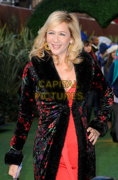 TANIA BRYER .Attending the 'Gnomeo And Juliet' UK film premiere, Odeon cinema, Leicester Square, London, England, UK,.30th January 2011..& arrivals half length black velvet collar coat hand on hip red dress floral print embroidered .CAP/CAN.©Can Nguyen/Capital Pictures.