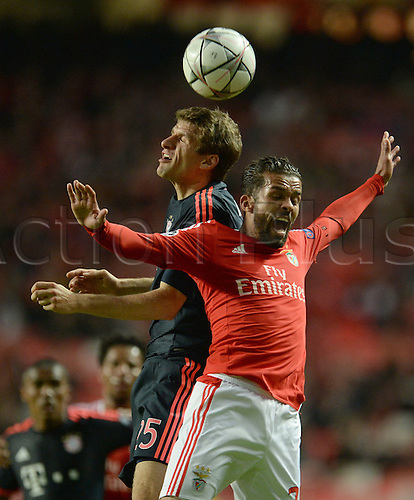 13.04.2016. Lisbon, Portugal.  Munich's Thomas Mueller (L) in action against Benifica's Alejandro Grimaldo (R) during the UEFA Champions League quarterfinal second leg soccer match between SL Benfica and FC Bayern Munich at Luz Stadium in Lisbon, Portugal, 13 April 2016.