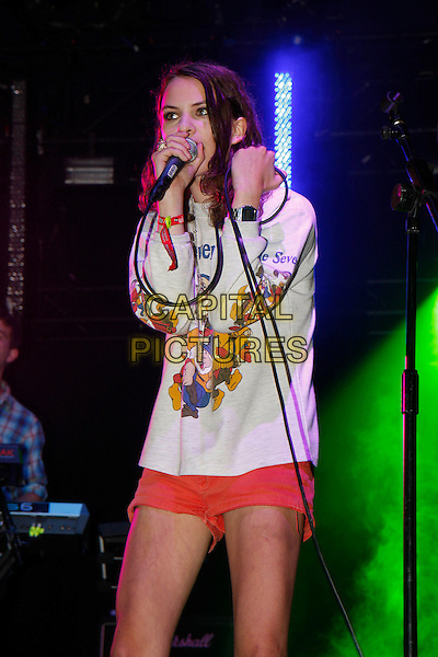 COCO SUMNER of I BLAME COCO.Performing live at Wireless Festival in Hyde Park, London, England, UK, .July 2nd 2010..concert music gig live on stage half length microphone singing Snow White and the Seven Dwarfs Dwarves print top white Disney shorts red long sleeved sleeve sweatshirt .CAP/MAR.© Martin Harris/Capital Pictures.