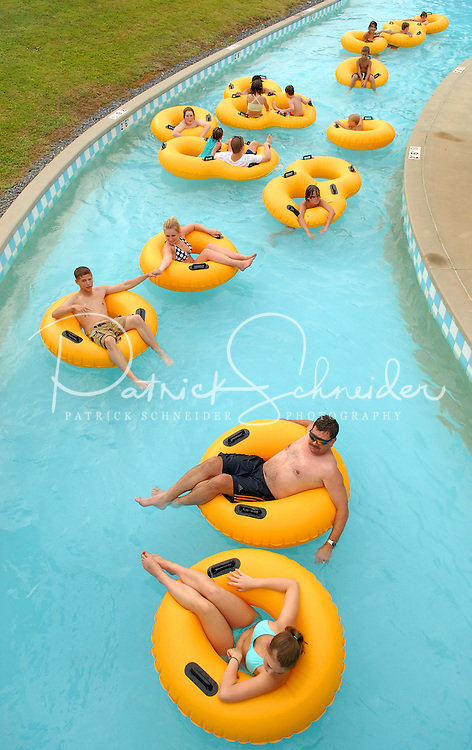 Patrons enjoy floating down the lazy river at Carowinds theme park near Charlotte NC.