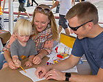The Brooks family draws during the Mural Marathon on Saturday June 30, 2018 in downtown Reno.