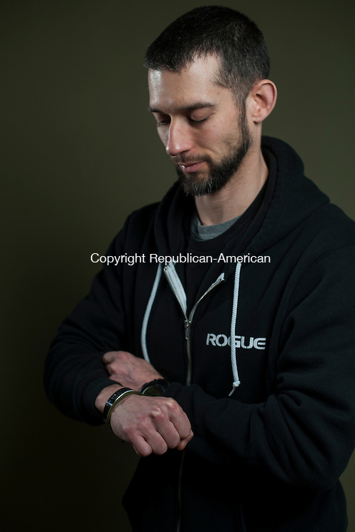 WATERBURY, CT- 23 May 2016-052316EC20-  Matt Harrington served in Iraq and Afghanistan. He wears a bracelet honoring Army Sgt. Ralph N. Porras, who died September of 2006 Serving During Operation Iraqi Freedom. Erin Covey Republican-American
