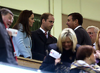 Pictured: Prince WIlliams with wife Kate Middleton speak to WRU chief executive Roger Lewis (R) on the stand. Saturday 08 November 2014<br />