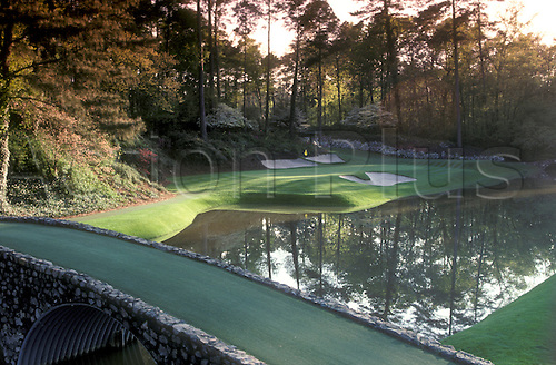 Augusta Golf Course Hole Number 12. The Augusta National Golf Club, located in Augusta, Georgia was founded by Bobby Jones and Clifford Roberts on the site of a former indigo plantation, the course was designed by Jones and Alister MacKenzie