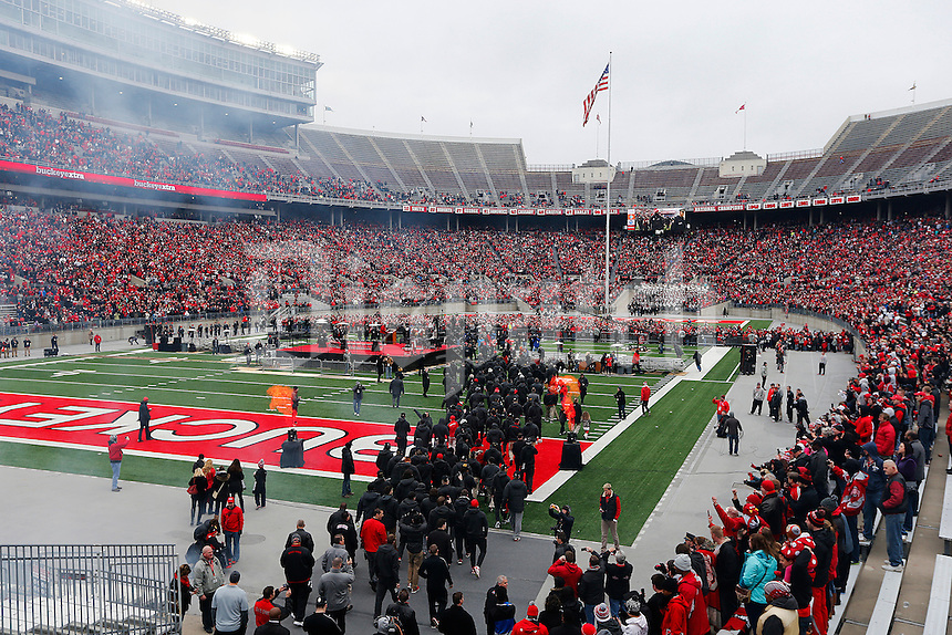 The team walks on to the field during the Ohio State Football National Championship Celebration at Ohio Stadium, Saturday morning, January 24, 2015. More than 40 thousand fans packed the lower stands in the stadium to celebrate the National Championship win with the football team. (The Columbus Dispatch / Eamon Queeney)