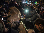 Kiev, Ukraine - 08 december 2013: The monument of Lenin on Tarasa Shevchenko boulevard had been destroyed by masked militants of nationalist party Svoboda (Freedom). People then gathered to destroy the statue and take home parts of the smashed granit Credit: Niels Ackermann / Rezo.ch