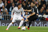 08.04.2012 SPAIN -  La Liga matchday 32th  match played between Real Madrid CF vs Valencia (0-0) and falls to 4 points behind Barcelona, at Santiago Bernabeu stadium. The picture show Mesut Ozil (German midfielder of Real Madrid) and Adil Rami  (Defender of Valencia)