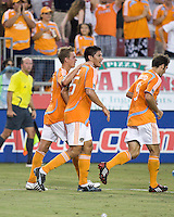 Houston Dynamo midfielder Stuart Holden (22), forward Brian Ching (25), and midfielder Brian Mullan (9) celebrate a goal.   Houston Dynamo defeated Toronto FC 3-1 at Robertson Stadium in Houston, TX on June 8, 2008.