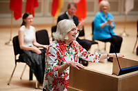 USA International Harp Competition Founder and Artistic Director Susann McDonald speaks during the opening ceremony of the 11th USA International Harp Competition at Indiana University in Bloomington, Indiana on Wednesday, July 3, 2019. (Photo by James Brosher)
