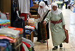 A picture taken on May 16, 2018 shows Palestinians shop at a market during the holy month of Ramadan, in the West Bank city of Nablus. Ramadan is sacred to Muslims because it is during that month that tradition says the Koran was revealed to the Prophet Mohammed. The fast is one of the five main religious obligations under Islam. Muslims around the world will mark the month, during which believers abstain from eating, drinking, smoking and having sex from dawn until sunset. Photo by Ayman Ameen