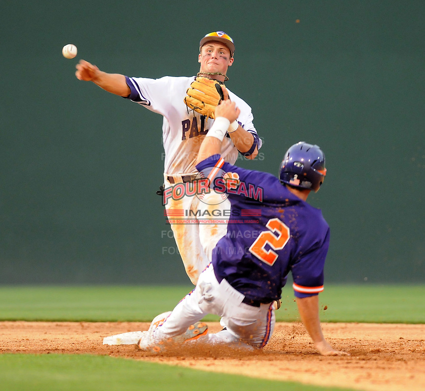 Second baseman Will Muzika (2) of the Furman Paladins makes the out at second against Jason Stolz (2) of the Clemson Tigers on Tuesday, May 10, 2011, at Fluor Field in Greenville, S.C. Muzika is from Dorman High School in Spartanburg. Photo by Tom Priddy / Four Seam Images