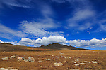 Clouds hang over the peak across the saddle from Mount Evans and Summit Lake in autumn, Rocky Mountains, Colorado, USA