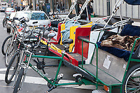 Pedicabs ready for hire near Columbus Circle in New York City