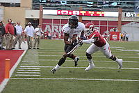 NWA Democrat-Gazette/MICHAEL WOODS • @NWAMICHAELW<br /> Texas Tech receiver Quan Shorts slips past Arkansas defender DJ Dean to score a touchdown in the 1st quarter of Saturday nights game at Razorback Stadium in Fayetteville.