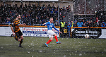 Kenny Miller shoots for goal in a snowstorm
