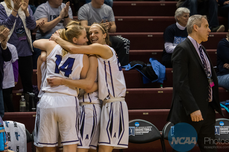 GRAND RAPIDS, MI - MARCH 18: Emma McCarthy (14) of Amherst College hugs her teammates in the final minutes during the Division III Women's Basketball Championship held at Van Noord Arena on March 18, 2017 in Grand Rapids, Michigan. Amherst College defeated Tufts University 52-29 for the national title. (Photo by Brady Kenniston/NCAA Photos via Getty Images)